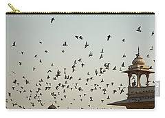 Carry-all Pouch featuring the photograph A Flock Of Pigeons Crowding One Of The Structures On Top Of The Red Fort by Ashish Agarwal