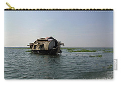 Carry-all Pouch featuring the photograph A Houseboat Moving Placidly Through A Coastal Lagoon In Alleppey by Ashish Agarwal