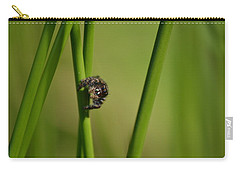 Carry-all Pouch featuring the photograph A Jumper In The Grass by JD Grimes