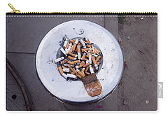 Carry-all Pouch featuring the photograph A Lot Of Cigarettes Stubbed Out At A Garbage Bin by Ashish Agarwal