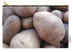 Carry-all Pouch featuring the photograph A Pile Of Large Lumpy Raw Potatoes by Ashish Agarwal