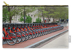 Carry-all Pouch featuring the digital art A Row Of Red Bikes by Eva Kaufman