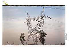 Carry-all Pouch featuring the photograph A Transmission Tower Carrying Electric Lines In The Countryside by Ashish Agarwal
