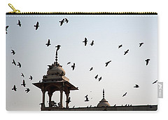 Carry-all Pouch featuring the photograph A Whole Flock Of Pigeons On The Top Of The Ramparts Of The Red Fort In New Delhi by Ashish Agarwal