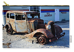 Carry-all Pouch featuring the photograph ...and Rotate The Tires by Larry Bishop