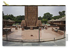 Carry-all Pouch featuring the photograph Base Of The Jallianwala Bagh Memorial In Amritsar by Ashish Agarwal
