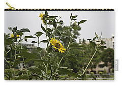 Carry-all Pouch featuring the photograph Beautiful Yellow Flower In A Garden by Ashish Agarwal