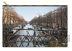 Carry-all Pouch featuring the digital art Bikes On The Canal In Amsterdam by Carol Ailles