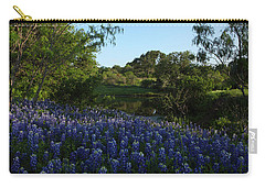 Carry-all Pouch featuring the photograph Bluebonnets At The Pond by Susan Rovira