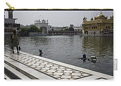 Carry-all Pouch featuring the photograph Clearing The Sarovar Inside The Golden Temple Resorvoir by Ashish Agarwal