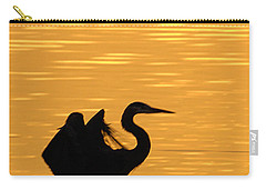 Carry-all Pouch featuring the photograph Great Blue Heron Landing In Golden Light by Randall Branham