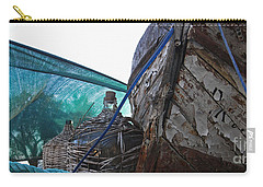 Carry-all Pouch featuring the photograph Old Boat And Flagons by Andy Prendy