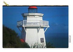 Carry-all Pouch featuring the photograph Pouto Lighthouse With Rainbow New Zealand by Mark Dodd