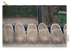 Rows Of Wooden Shoes Carry-all Pouch by Carol Ailles