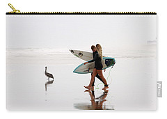 Carry-all Pouch featuring the photograph Surfers And A Pelican by Alice Gipson