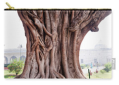 Carry-all Pouch featuring the photograph The Twisted And Gnarled Stump And Stem Of A Large Tree Inside The Qutub Minar Compound by Ashish Agarwal