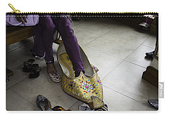 Carry-all Pouch featuring the photograph Trying On A Very Large Decorated Shoe by Ashish Agarwal