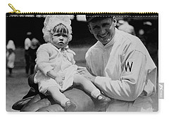 Carry-all Pouch featuring the photograph Walter Johnson Holding A Baby - C 1924 by International  Images