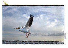 Carry-all Pouch featuring the photograph White Pelican Flying Over Island by Dan Friend