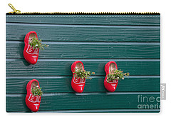 Carry-all Pouch featuring the digital art Wooden Shoes On Teh Wall by Carol Ailles