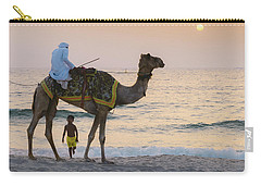 Little Boy Stares In Amazement At A Camel Riding On Marina Beach In Dubai, United Arab Emirates -  Carry-all Pouch