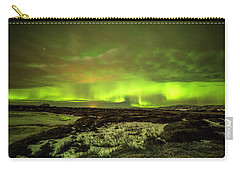 Aurora Borealis Over A Frozen Lake Carry-all Pouch by Joe Belanger
