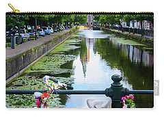 Carry-all Pouch featuring the digital art Canal And Decorated Bike In The Hague by RicardMN Photography