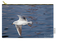 Flying Gull Above Water Carry-all Pouch by Michal Boubin