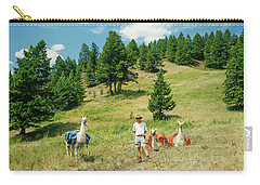 Man Posing With Llamas In A Beautiful Grassy Meadow Carry-all Pouch by Jerry Voss