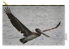 Pelican In Flight Carry-all Pouch by Laurel Talabere