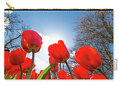 Carry-all Pouch featuring the photograph Red Tulips Against Blue Sky by Hans Engbers