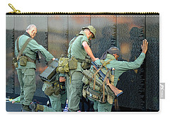 Carry-all Pouch featuring the photograph Veterans At Vietnam Wall by Carolyn Marshall