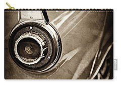 Carry-all Pouch featuring the photograph 1956 Ford Thunderbird Taillight Emblem -0382s by Jill Reger