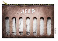 Carry-all Pouch featuring the photograph 1957 Jeep Emblem -0597ac by Jill Reger