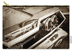 Carry-all Pouch featuring the photograph 1963 Chevrolet Taillight Emblem -0183s by Jill Reger