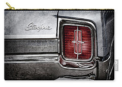 Carry-all Pouch featuring the photograph 1965 Oldsmobile Starfire Taillight Emblem -0212ac by Jill Reger