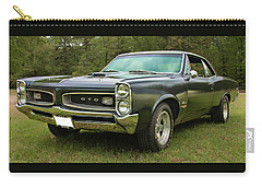 Carry-all Pouch featuring the photograph 1966 Black Gto by Daniel Adams