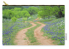 A Dirt Road Lined By Blue Bonnets Of Texas Carry-all Pouch