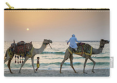 A Little Boy Stares In Amazement At A Camel Riding On Marina Beach In Dubai, United Arab Emirates Carry-all Pouch