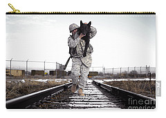 A Military Dog Handler Uses An Carry-all Pouch