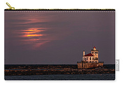 A Moonsetting Sunrise Carry-all Pouch by Everet Regal