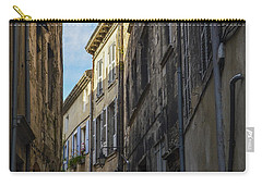 Carry-all Pouch featuring the photograph A Narrow Street In Viviers by Allen Sheffield