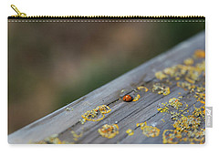 Carry-all Pouch featuring the photograph A Red Dot That Moves by Lora Lee Chapman