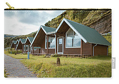 Carry-all Pouch featuring the photograph A Row Of Cabins In Iceland by Edward Fielding