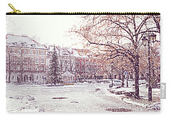 Carry-all Pouch featuring the photograph A Street In Warsaw, Poland On A Snowy Day by Juli Scalzi