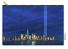 Carry-all Pouch featuring the photograph A Tribute At Dusk by Chris Lord