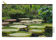 Carry-all Pouch featuring the photograph A Water Garden by Byron Varvarigos