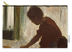 A Woman Ironing Carry-all Pouch by Edgar Degas