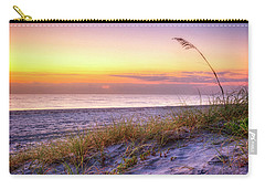 Carry-all Pouch featuring the photograph Alone At Dawn by Debra and Dave Vanderlaan