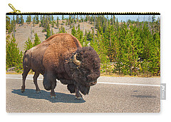 Carry-all Pouch featuring the photograph American Bison Sharing The Road In Yellowstone by John M Bailey